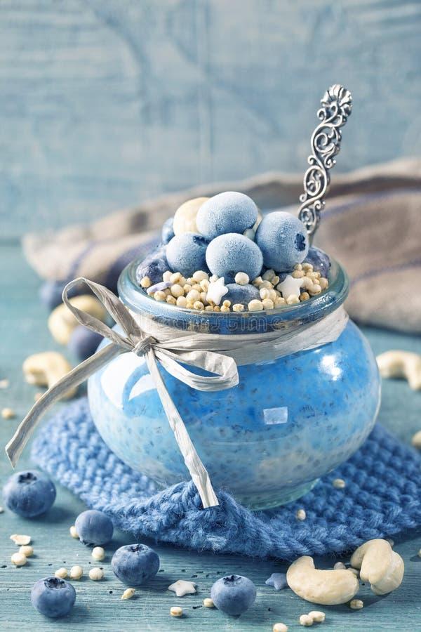 Blue spirulina pudding stock image