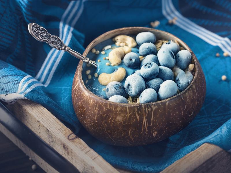 Blue spirulina smoothie bowl royalty free stock photos