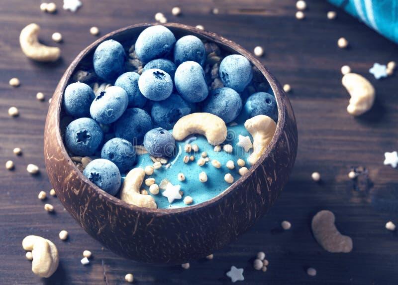 Blue spirulina smoothie bowl stock photography
