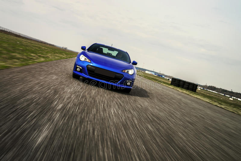 Blue sport car on race way. Motion capture stock images
