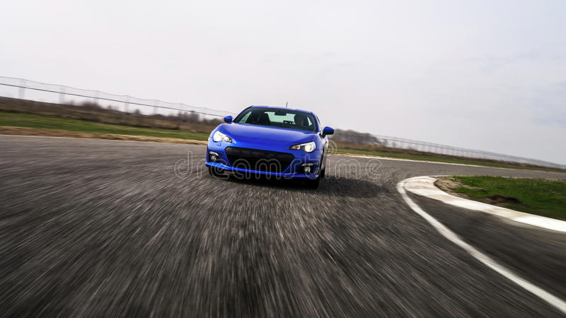 Blue sport car on race way. Motion capture royalty free stock photography