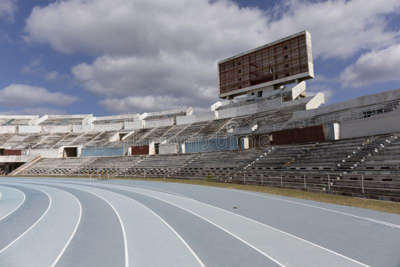 Blue sport track for running on stadium with tribune. Running healthy lifestyle concept stock photo