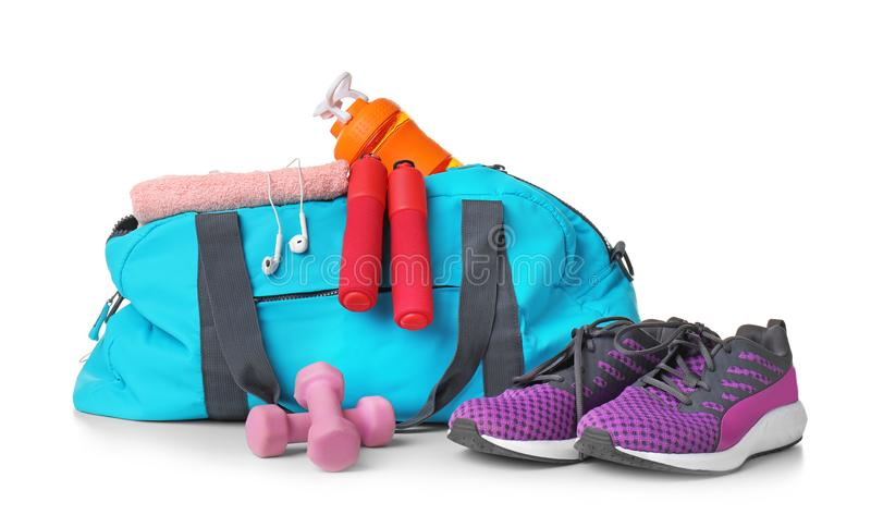 Sports bag and gym equipment on white background. Blue sports bag and gym equipment on white background stock image
