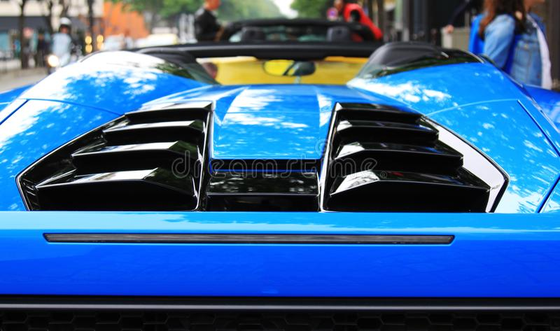 Blue sports car spoiler stock images
