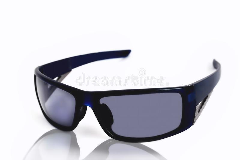 blue sports glasses on a white background, reflection stock photo