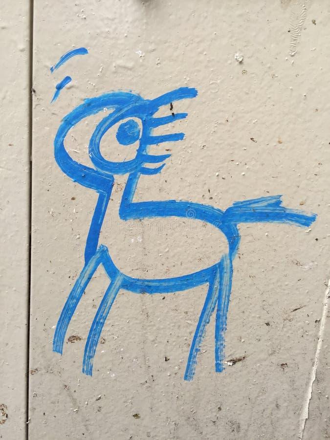 Blue spray paint pony royalty free stock image