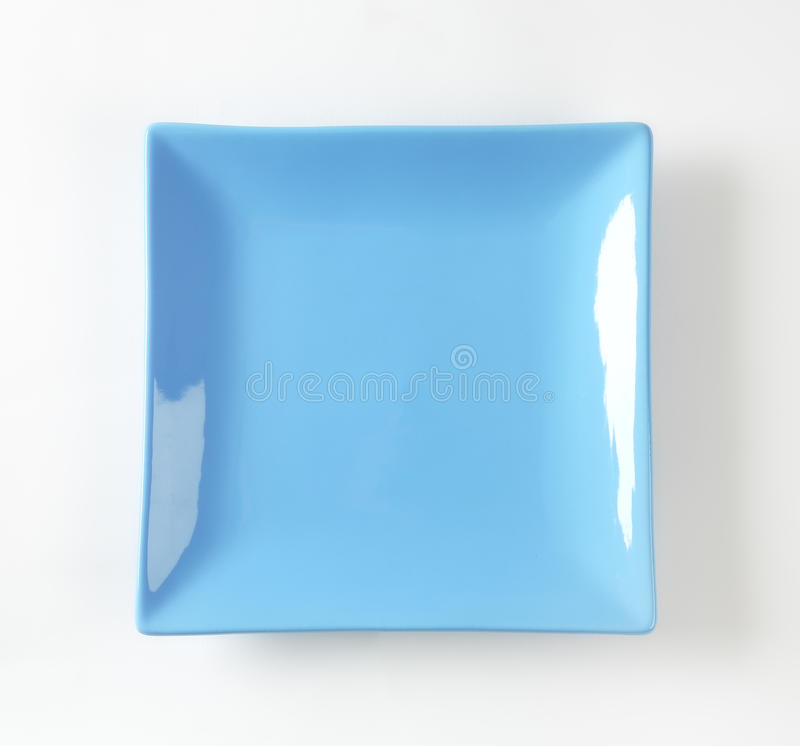 Blue square plate. On white background royalty free stock photography