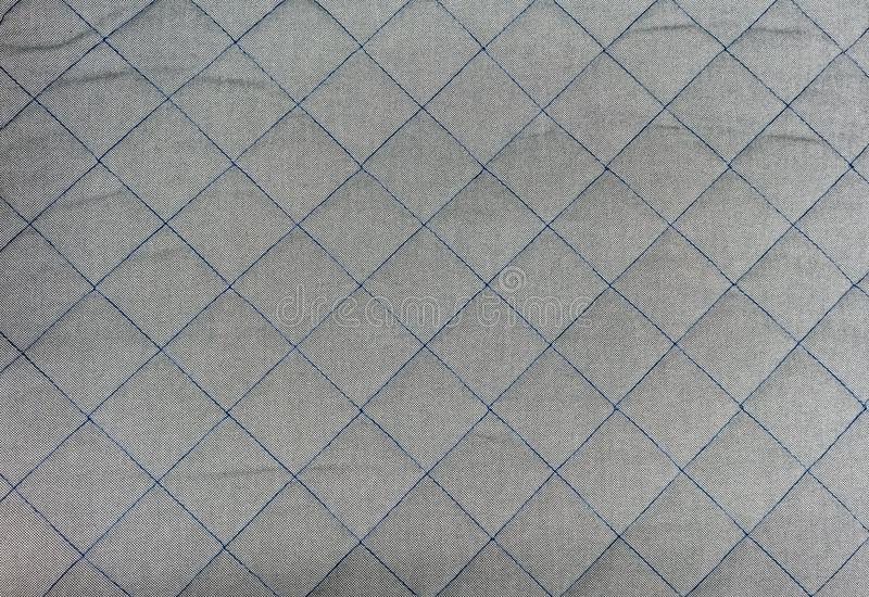 Blue square stitched on silver grey quilt seamless background pa royalty free stock images