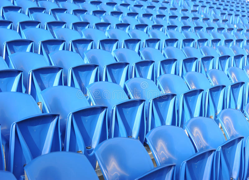 Blue stadium chairs stock image