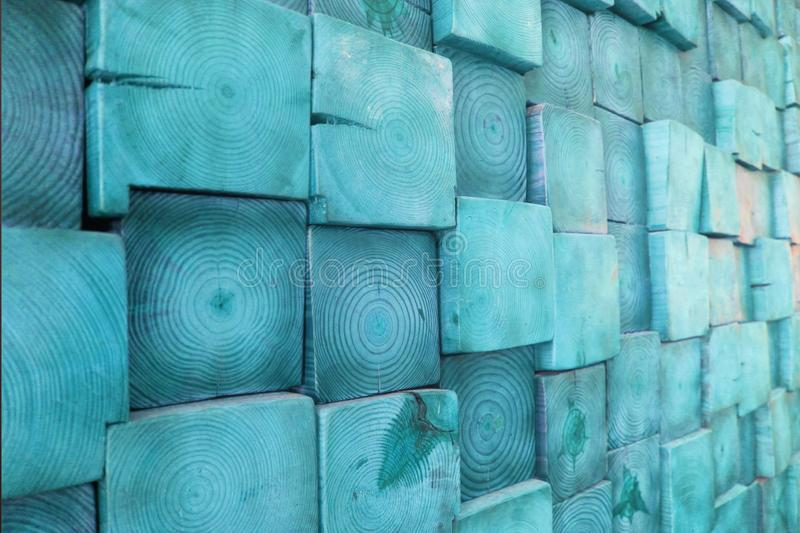 Blue Stained Wood Block Wall, Showing Wood Grain and Cracks - Rustic Home Decor. Blue Stained Wood Blocks Background - Beautiful Pattern Showing Wood Grain and royalty free stock photography