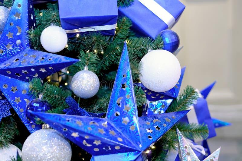 Blue stars, Christmas white balls, gift boxes royalty free stock photo