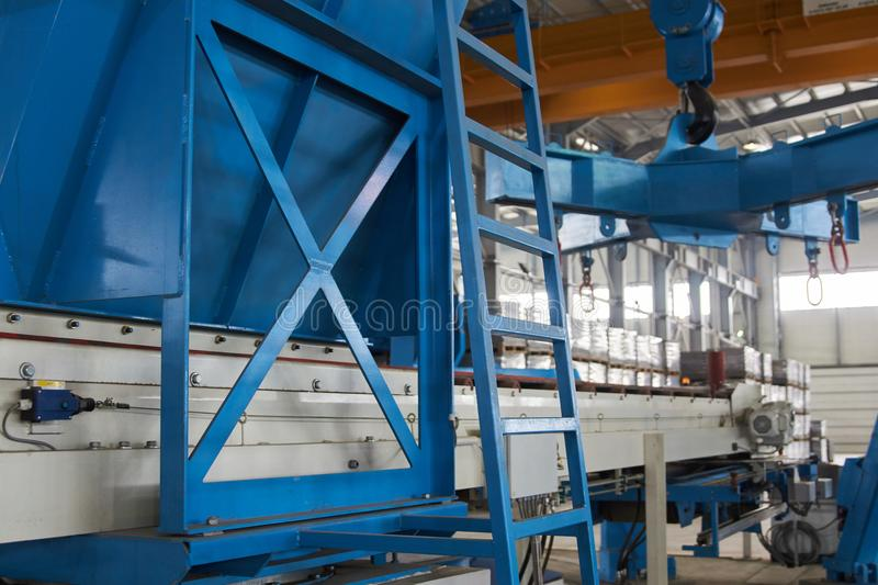 Blue steel ladder in factory warehouse interior. Close-up stock photos