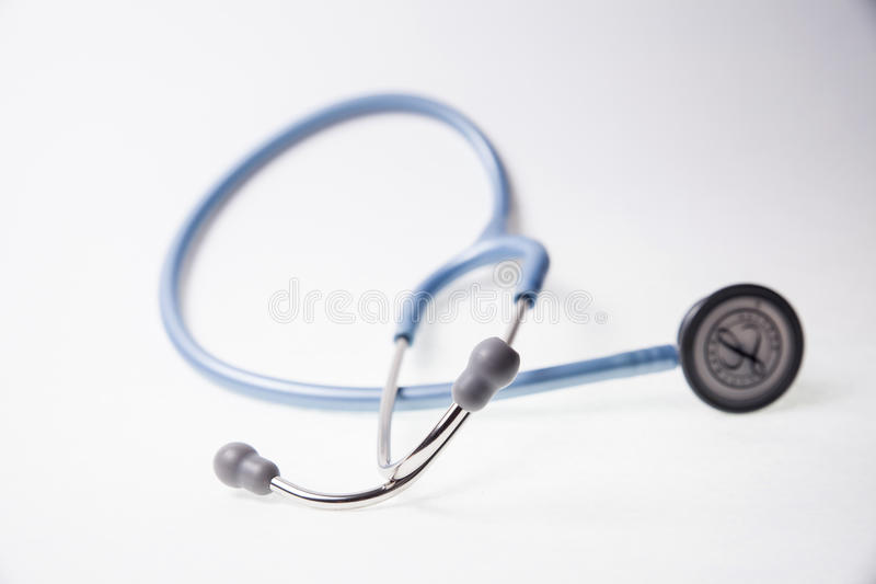 Blue stethoscope on a white background stock images