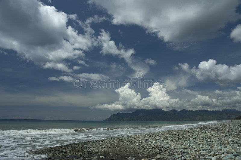 Blue stone beach royalty free stock photos