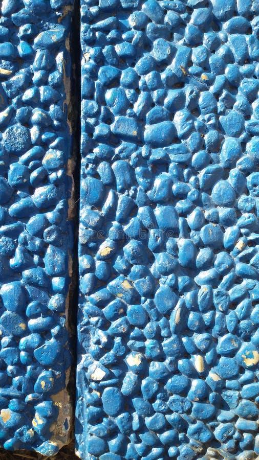 Blue stones background. Little stones texture. stock photo