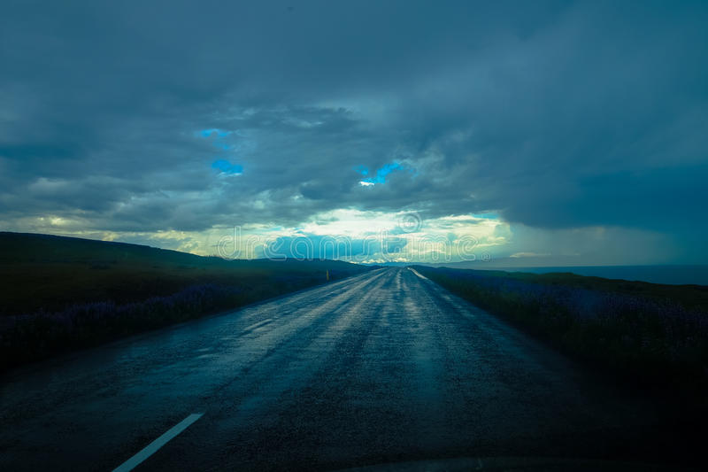 Blue storm clouds over empty road stock photography