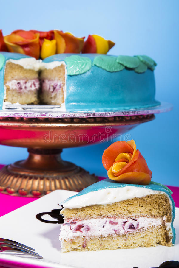 Blue strawberry layer cake royalty free stock photography