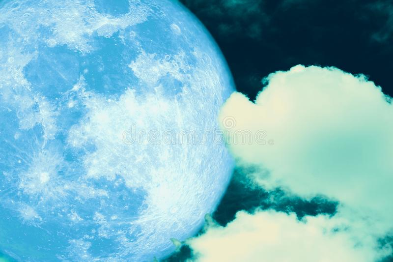 Blue strawberry moon back on silhouette cloud on night sky. Elements of this image furnished by NASA, apogee, background, blood, bloody, bright, buck, corn stock image