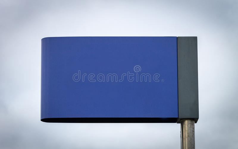 Advertisement Mockup Street Sign - Blue. Blue Street Sign Advertisement Mockup. Copy Space. Iron Pole. Cloudy Background stock photo