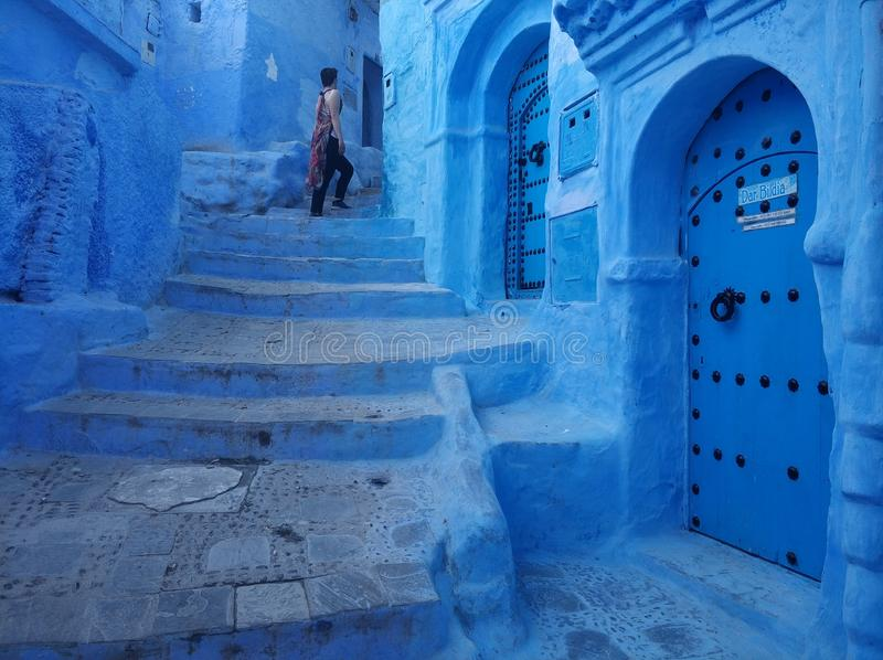Blue old doors and steep stairs in Chefchaouen magic misterious blue streets royalty free stock photo