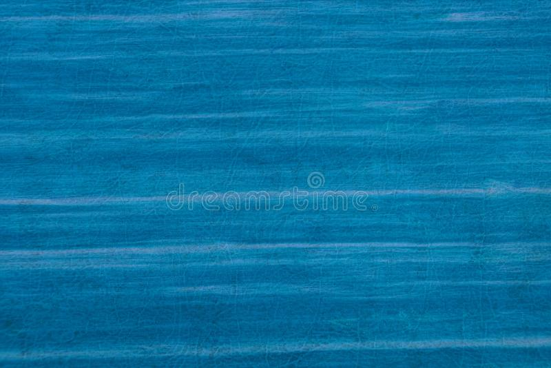 Blue striped plastic texture from an old cover royalty free stock photos
