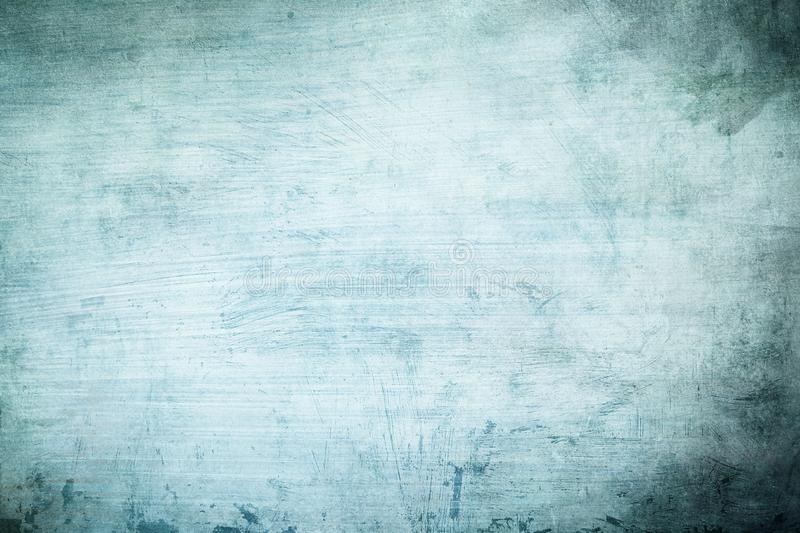Blue strokes abstract background or texture. Detail of old distressed blue wall background or texture with dark vignette borders royalty free stock images