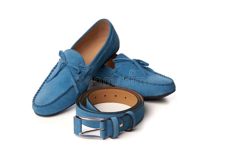 Blue suede man`s moccasins shoes isolated on white royalty free stock images