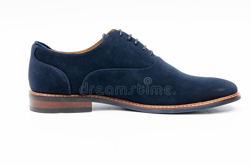 The blue suede shoes isolated on white background stock photo