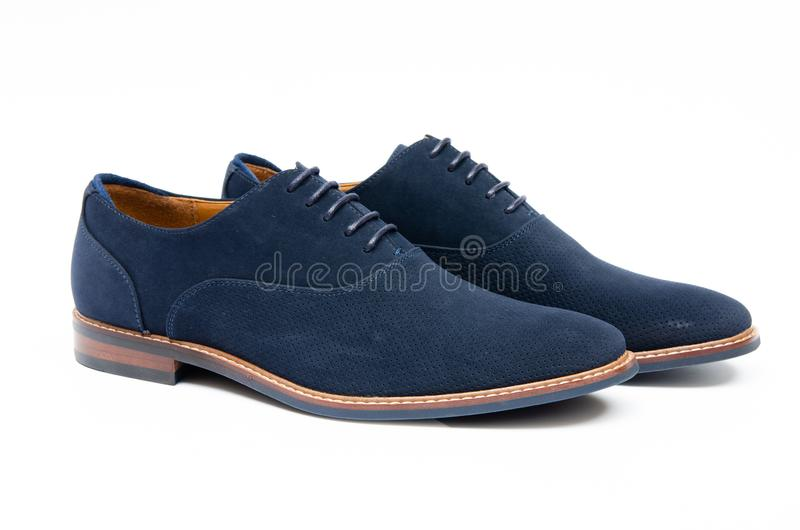 The blue suede shoes isolated on white background stock photography