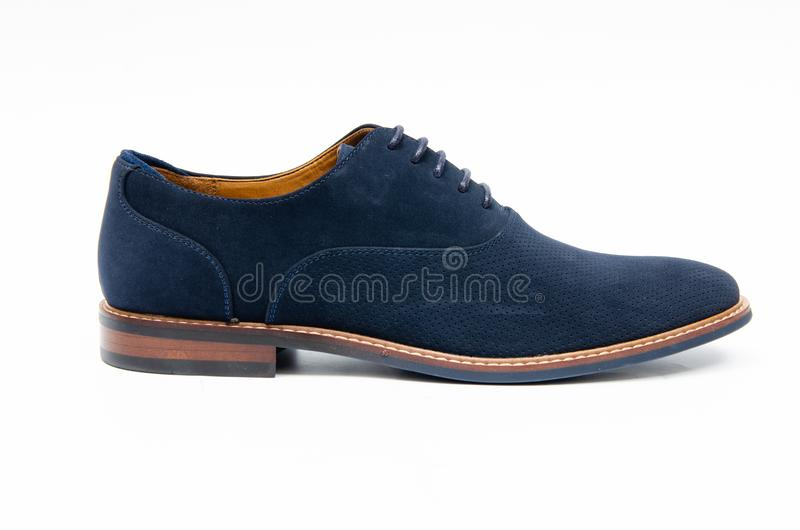 The blue suede shoes isolated on white background stock image