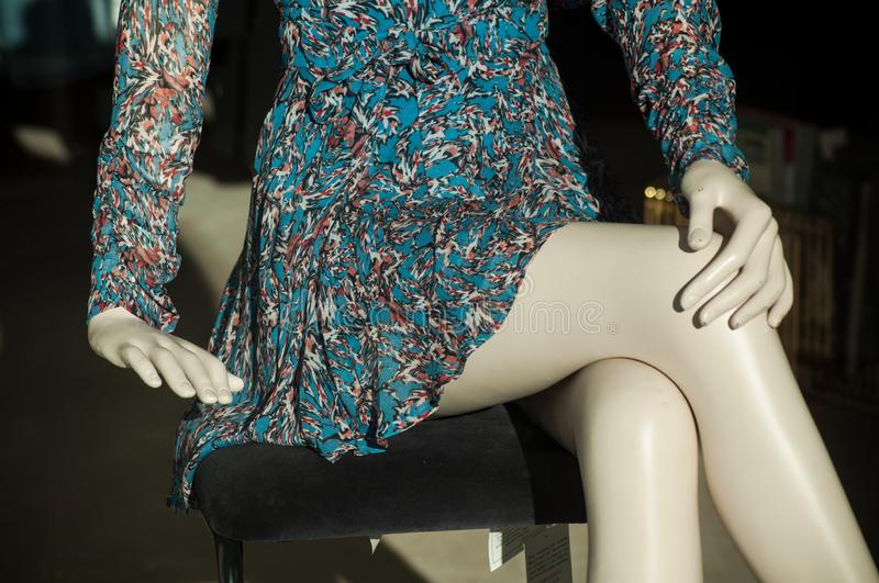 Blue summer dress on mannequin legs retail in fashion store showroom for women. Closeup of blue summer dress on mannequin legs retail in fashion store showroom stock images