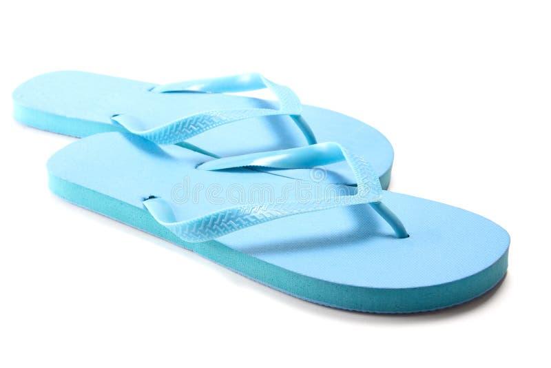 Blue summer flip flops over white. Background stock photo