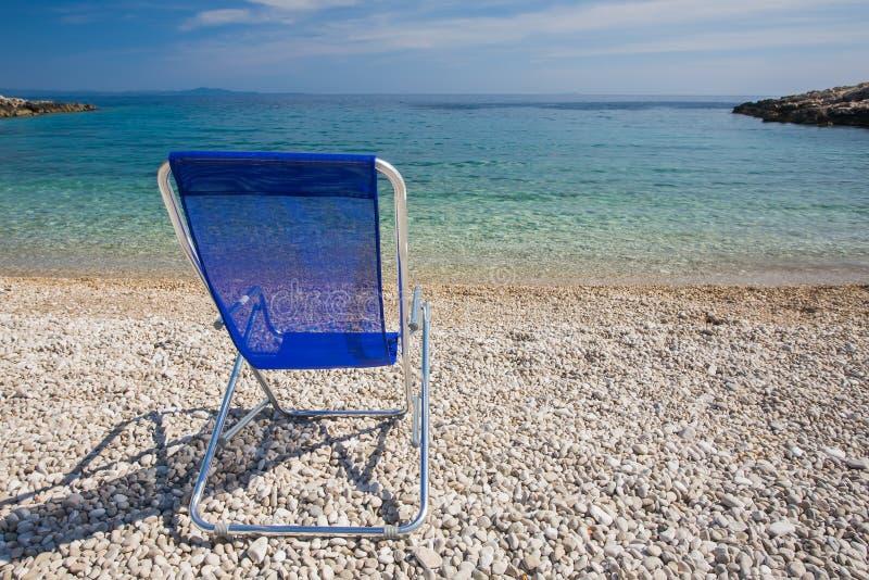 Blue Sunchair on the beach royalty free stock image