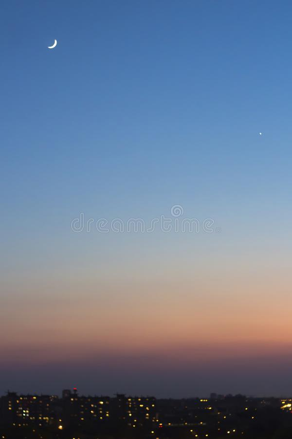 Blue sunset sky with crescent royalty free stock photo