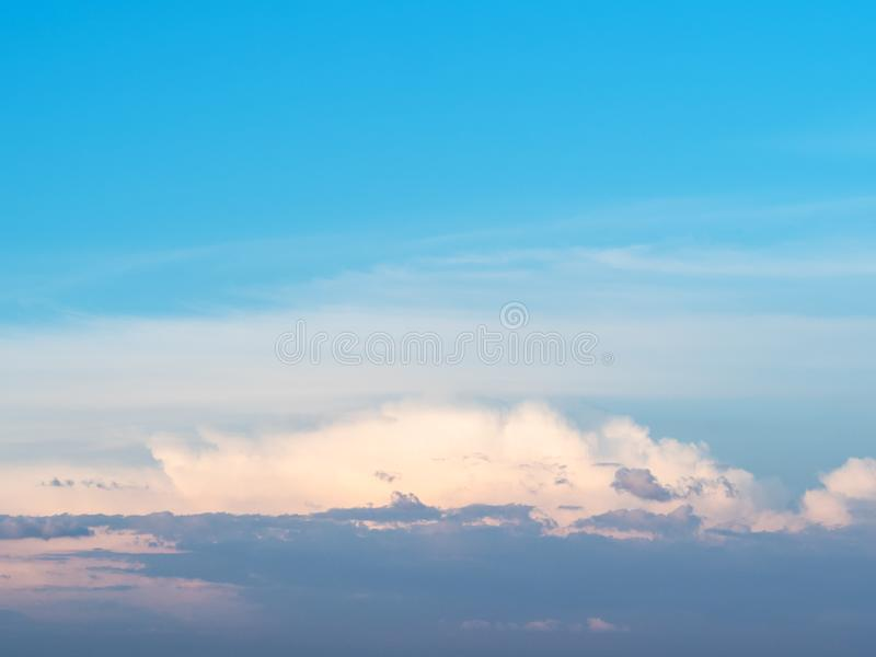 Blue sunset sky with gray, pink and white clouds. Blue sunset sky with low dark gray, pink and white cloud in summer evening stock images