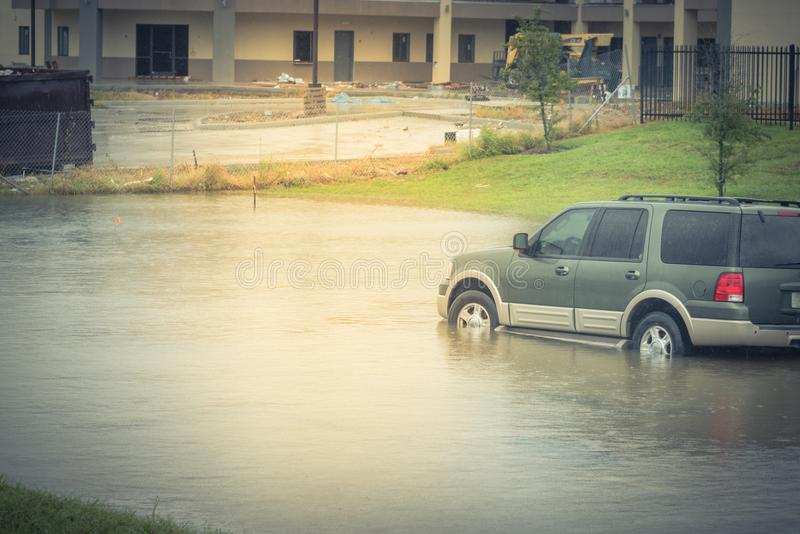 Car swamped by hurricane flood water in East Houston, Texas, USA. Blue SUV car swamped by flood water in East Houston, Texas, US by Tropical Storm. Submerged car royalty free stock photos