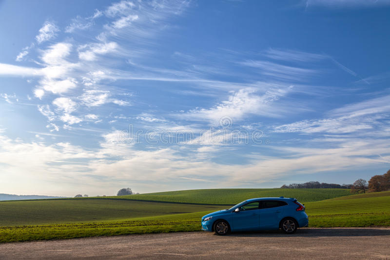 Blue Suv Near Green Plains Under White Cloudy Sky During Daytime Free Public Domain Cc0 Image