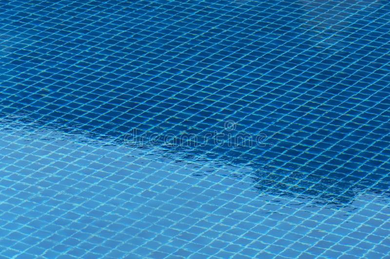 Blue swimming pool for relaxation or refreshment traveling  in summer time background. Blue swimming pool pattern tile for relaxation or refreshment traveling royalty free stock photography