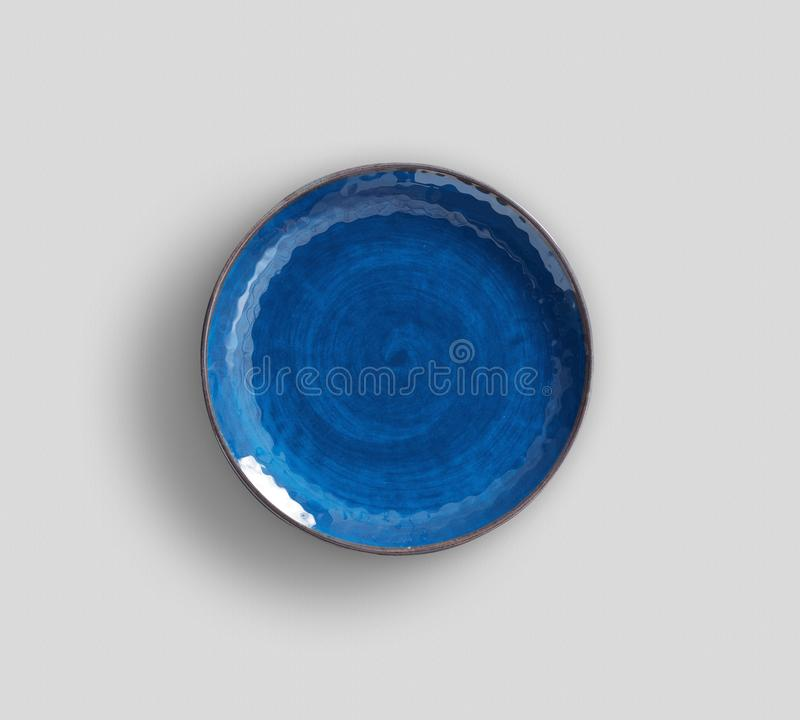 Blue Swirl Melamine Plate with light gray background royalty free stock photo
