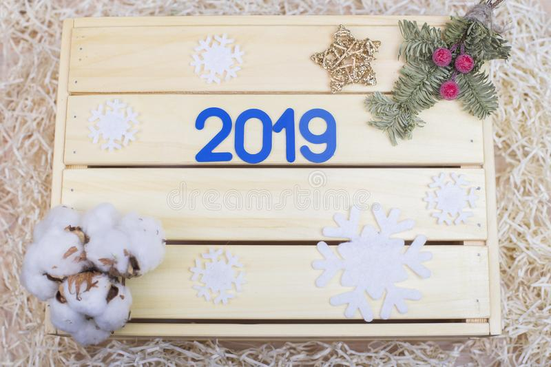 Blue symbol with number 2019 and new year decor on wooden background. New Year 2019. Blue symbol with number 2019 and new year decor on wooden background stock image
