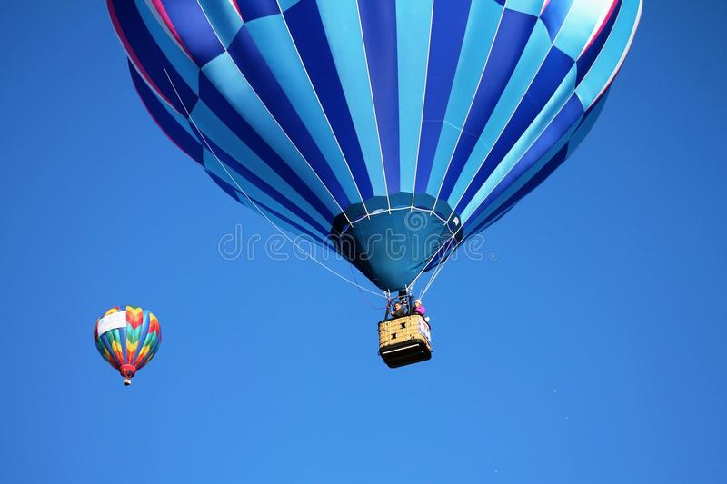 Blue and Teal Hot Air Balloon Near Pink and Blue Hot Air Balloon royalty free stock images
