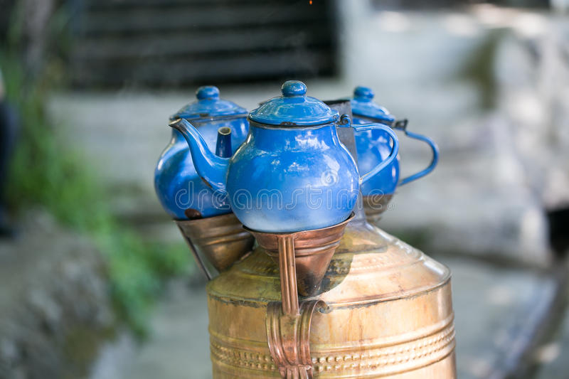 Traditional Turkish blue teapots placed above copper samovar stock image