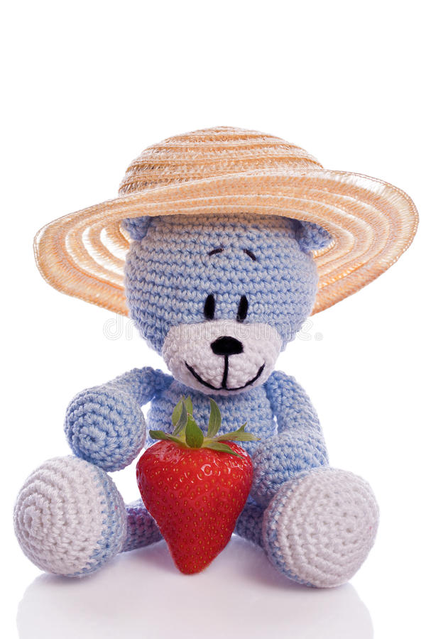 Blue teddy bear with hat and fresh strawberries royalty free stock image