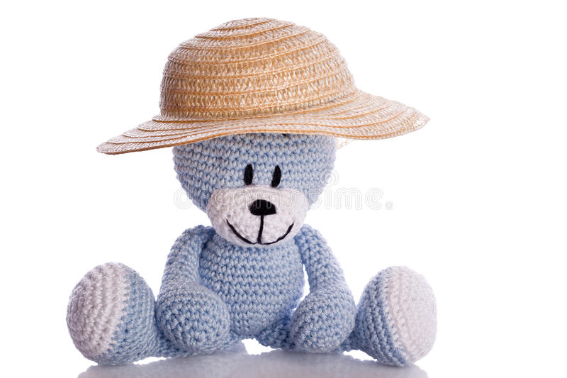 Blue teddy bear with sun hat stock images