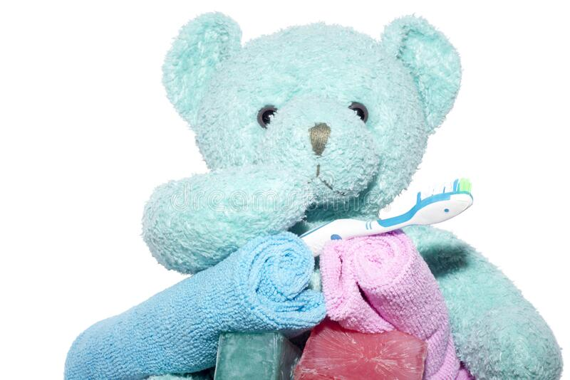Blue teddy bear with toothbrush soap and facecloths royalty free stock images