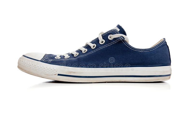 Blue tennis shoe on white stock photos