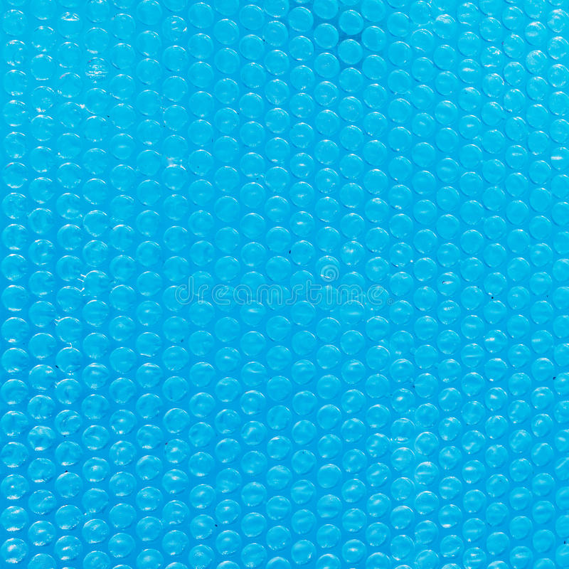 Blue texture of Bubble wrap on water. Close up royalty free stock image
