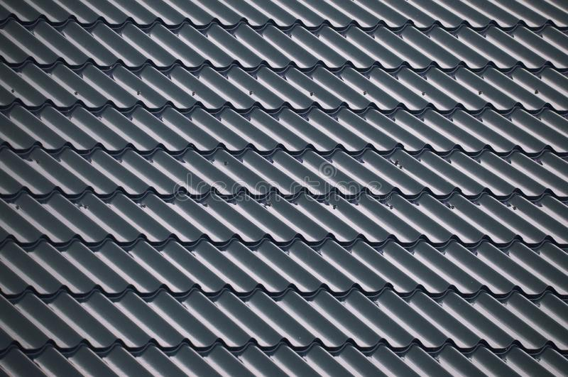 Blue textured tiles that cover the roof stock photo