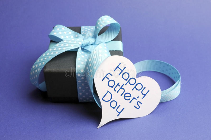 Happy Fathers Day blue theme gift and message on heart tag stock photo