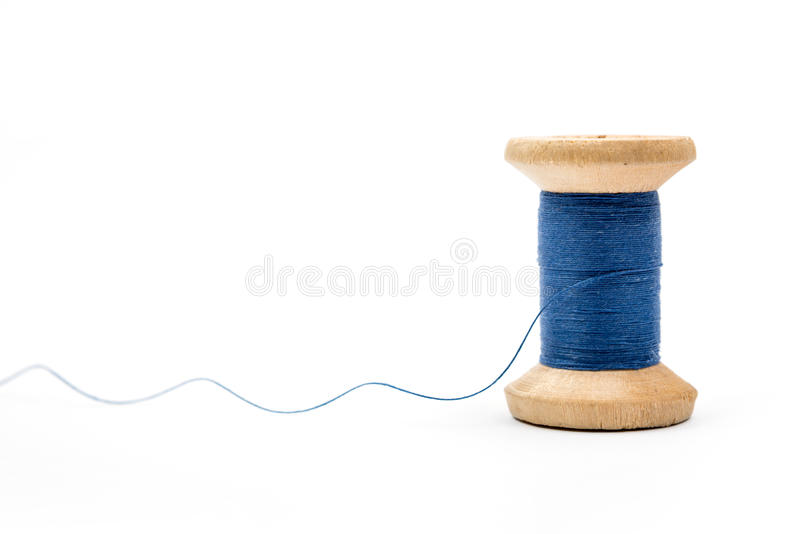 Blue thread spool. Isolated on white background royalty free stock photo